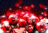Christmas baubles in red, close-up, with stars and snowflakes in the background