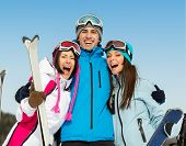 Half-length portrait of group of embracing skier friends. Concept of cute winter sport and funny vacations with friends