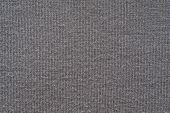 Texture From A Soft Knitted Fabric Of Dark Color