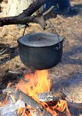 Smoked Tourist kettle on fire in forest camp