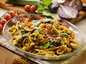 pasta with eggplants zucchinis tomatoes and curry