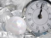 image of pendulum clock  - clock striking midnight silver in holiday decor - JPG