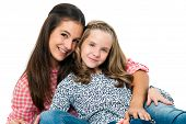 Portrait Of Cute Teen Girl With Younger Sister.