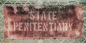 foto of chain link fence  - Retro Filtered Photo Of Rusty Grungy Old Penitentiary Prison Sign On Chain Link Fence - JPG