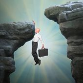Senior businessman on a edge of cliff. Career and insurance metaphor.