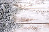Christmas decoration with fir, snow and white,  wooden background