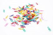 Color paper clips on white