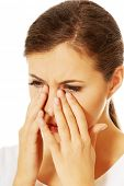 stock photo of sinuses  - Young woman with sinuses pain - JPG