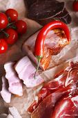 pic of deli  - Assortment of deli meats on parchment background - JPG