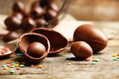 stock photo of easter candy  - Chocolate Easter Eggs on wooden background - JPG