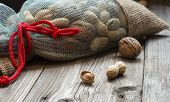foto of ground nut  - Full bag of nuts isolated on wood