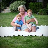 picture of nic  - Happy grandmother holding twin boys - JPG