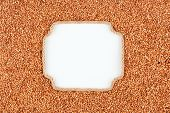 picture of buckwheat  - Figured frame made of rope with buckwheat grains lying on a white background with place for your text graphics - JPG