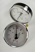 foto of barometer  - industrial barometer and thermometer on a white background - JPG