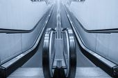 pic of escalator  - Empty moving escalator stairs in the supermarket - JPG