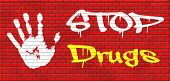 picture of drug addict  - stop drug addiction no drugs addict cocaine heroin crack christal meth graffiti on red brick wall - JPG