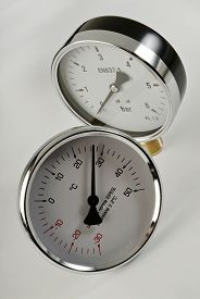 stock photo of barometer  - industrial barometer and thermometer on a white background - JPG