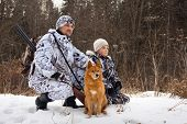 Постер, плакат: The Hunter With His Son And Their Dog