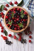 image of blackberries  - Salad of cherry raspberry currant and blackberry in a wooden bowl on the table - JPG