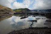picture of ashes  - Glacier in Iceland covered with volcano ash - JPG