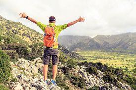 image of climb up  - Happy climber hiker winning reaching life goal success man at summit successful business concept - JPG