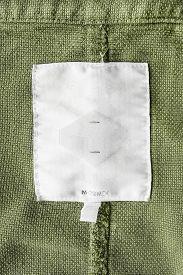 pic of khakis  - Blank white clothes label on khaki cloth - JPG