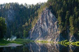 stock photo of perm  - beautiful rock Duzhnoy on the river Chusovaya landscape monument of nature Perm region Russia - JPG