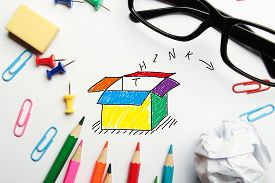 stock photo of thinking outside box  - Think outside the box concept with some office supplies around it on white background - JPG