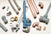 Selection Of Plumbers Tools And Plumbing Materials poster