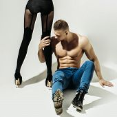Muscular Man And Sexy Girl poster