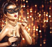 Beauty Glamour Woman celebrating with champagne, wearing carnival mask. party, drinking champagne ov poster