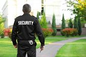 Male security guard in park poster