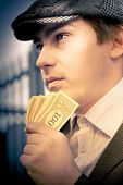 Man Holding Money Making A Financial Decision