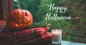 Background Halloween Pumpkin On A Cozy Window Sill With A Red Plaid. Whole Pumpkin And Sparkler Outd poster