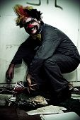 image of scourge  - Mr Squatter The Unemployed Clown Smiles While Squatting In An Dirty Old Abandoned House