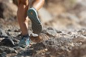 Athlete With Athletic Sneakers Jogging Or Running Nature. Athlete Runs On Mountain Rocky Path. Healt poster