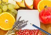 stock photo of recipe card  - blank notebook for recipes with frame of fruits