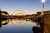 stock photo of tyne  - Illuminated Tyne bridges reflected in the river at twilight - JPG