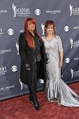 LAS VEGAS - APRIL 3 - Wynonna Judd and Naomi Judd of The Judds attend the 46th Annual Academy of Cou
