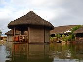 Restaurant Dining Tables On Artificial Tropical Pond