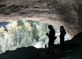 Two Folks In Cave Dwelling