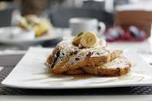 stock photo of french toast  - Cinnamon raisin french toast with maple syrup and french bananas