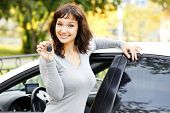 stock photo of car key  - Pretty asian girl showing the car key - JPG