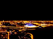 Abstract Blurred Background Aerial Night View Of A Big City. Cityscape Panorama Bokeh At Night. Blur poster