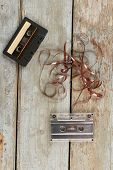 Two Audio Cassettes On Wooden Background. Audio Tapes On Rustic Wooden Planks, Vertical Image. poster