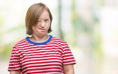 Young adult woman with down syndrome over isolated background winking looking at the camera with sex poster
