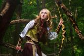 stock photo of hermaphrodite  - Elf holding a bow with an arrow - JPG