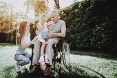 Happy Family On Nature With Child. Family And Caregiver. Child And Old Man. Health Girl With Aged. H poster