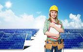 smiling engineer and solar panel background