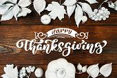 White Pumpkin, Berries And Leaves On A Wooden Autumn Background With Text Happy Thanksgiving. Mockup poster